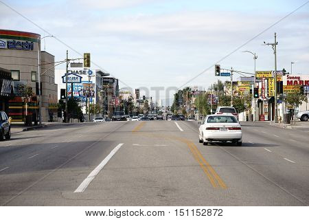 LOS ANGELES, UNITED STATES - DECEMBER 27: Road traffic on a main road in Koreatown with various shops and stores on December 27, 2015 in Los Angeles.
