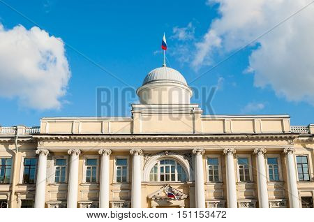 Leningrad Regional Court building on the Fontanka River in Saint Petersburg Russia - closeup facade view with Russian flag on the roof flagpole in sunny day