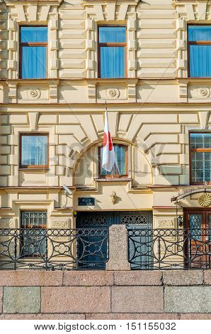 ST PETERSBURG, RUSSIA - OCTOBER 3, 2016. The Consulate General of Japan in Saint Petersburg- building at Moika river embankment. It is the consulate of Japan in Saint Petersburg Russia- closeup facade view with Japanese flag at the entrance