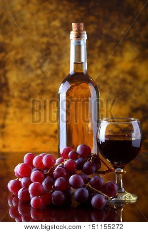 White wine composition with grape and glass of red wine