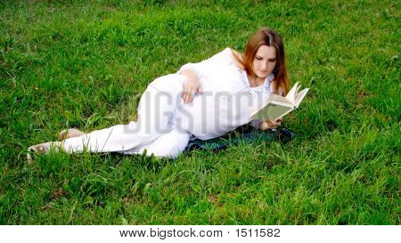 Pregnant Woman With Book 2
