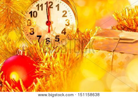 Christmas composition with alarm-clock ornaments and yellow highlights close up. Foreground is blurred focus on the dial