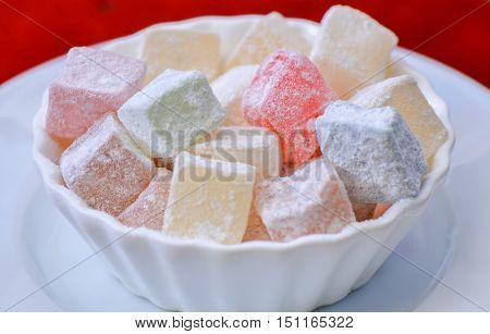 Turkish delight in a plate ,isolated, closeup.