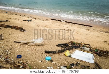 Styrofoam on beach, pollution, waste on beach, garbage on shore.