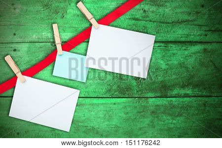 Note paper on wooden green background. for design.