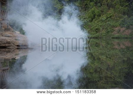 Smoke and fog floating on the river.
