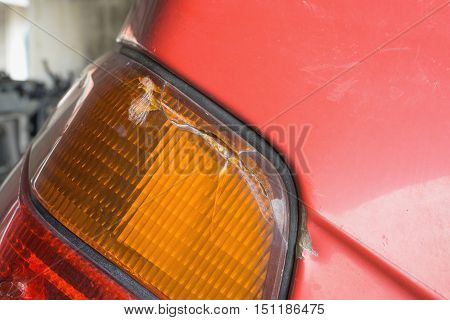 Broken damaged car taillight with selective focus