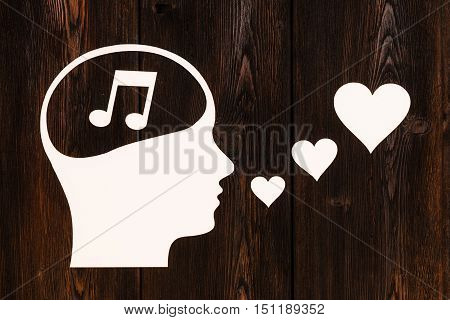Paper head with music note inside, singing. Love concept. Abstract conceptual image