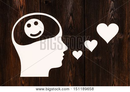Paper head with smile icon inside, singing. Love concept. Abstract conceptual image