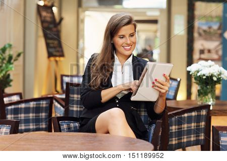 Picture of young businesswoman working in cafe