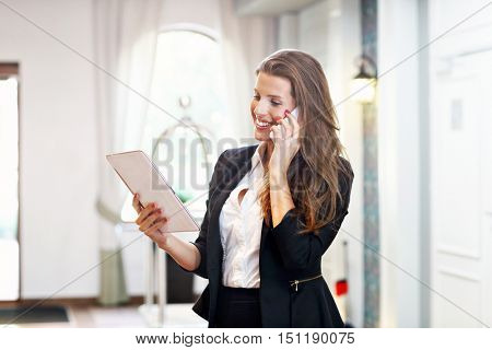 Picture of young businesswoman working in lobby