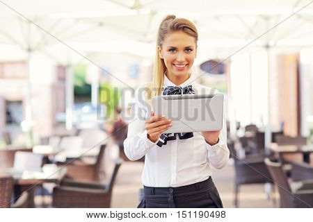 Young businesswoman working in cafe
