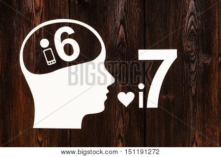 Paper head with smartphone 6 inside and model 7 near. Mobile phone concept. Abstract conceptual image