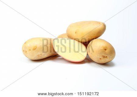 Potato new fresh red yellow on white background