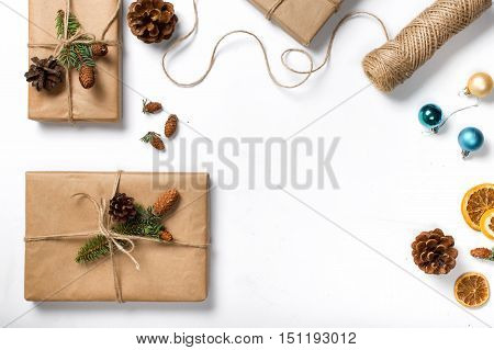 Gift handmade on white background with copy space top view flat lay. Christmas background