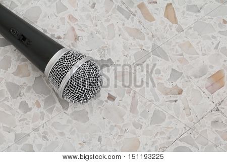 Microphone dynamic on floor marble polished stone background