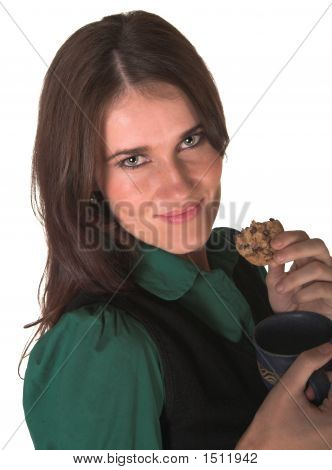 Professional Young White Lady Looking At Me Eating A Biscuit Green Shirt