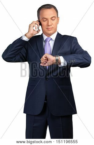Portrait of a Businessman Looking at his Watch While on the Phone