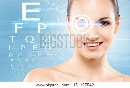 Beautiful girl with laser surgery concept over blue background.