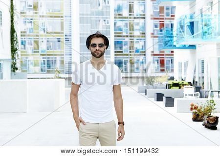 Man dressed in white t-shirt portrait in town
