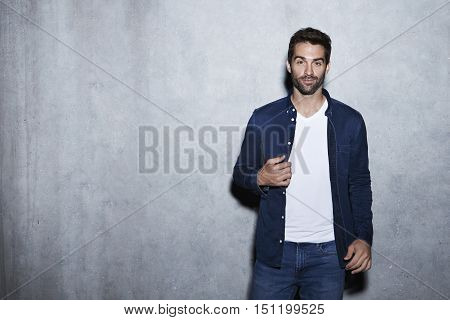 Cool dude in blue shirt and jeans portrait