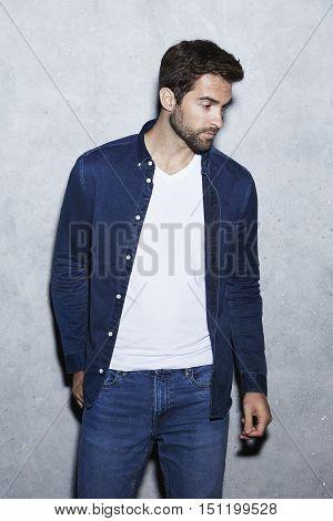 Man wearing blue fashion looking away in studio