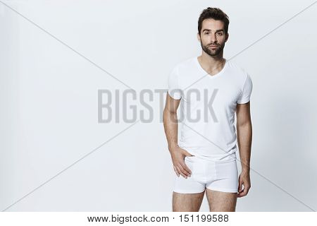 Guy in white underpants looking at camera