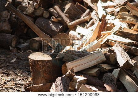 Axe cut into wood after chopping firewood
