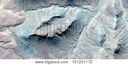 abstract composition in green and turquoise stone in desert landscape of Africa from the air, photography bird's eye view of African deserts, Collection of abstract naturalism of Munimara