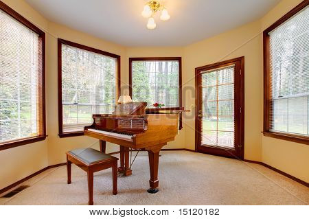 Round Piano Room With Many Bright Windows