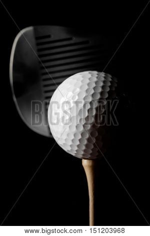 Closeup of Golf Club and Golf Ball on Tee, Isolated on White Background