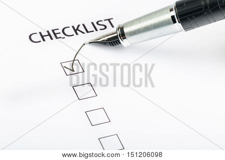 Parker Marking in a Checkbox with Fountain Pen on the Sheet of Paper - Isolated