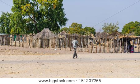 Caprivi, Namibia - August 20, 2016: Poor Man Walking On The Roadside In The Rural Caprivi Strip, The