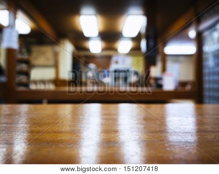 Table top Counter with Blurred Bar Restaurant Shop interior