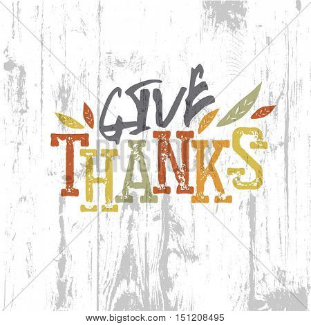 Happy Thanksgiving design. Give Thanks Logo. For holiday greeting cards designs. On wooden texture background