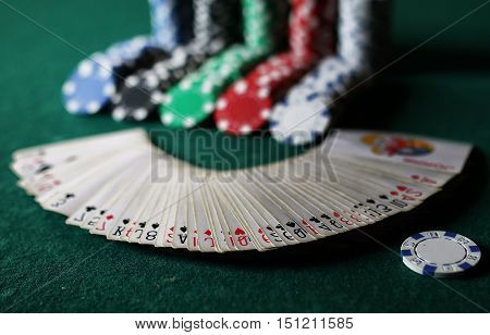poker chips on the green textile table