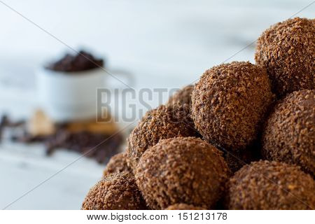 Pile of brown sweets. Dark candies with crumbs. Freshly made chocolate balls. Mixture of cookies and butter.