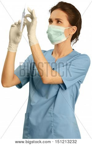Female healthcare worker wearing a face mask and scrubs while holding an injection