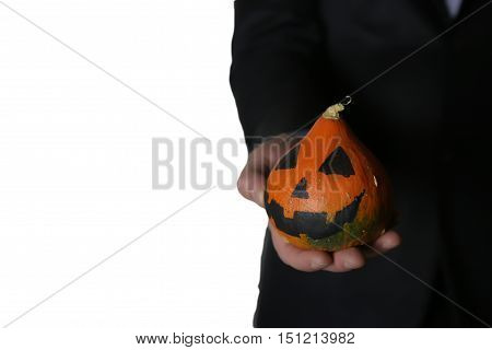 man in suit with pumpkin head halloween concept