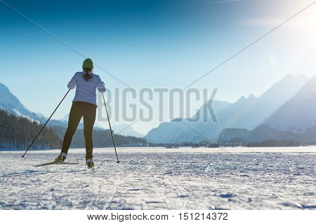 Woman practicing Nordic skiing with modern technique in skating