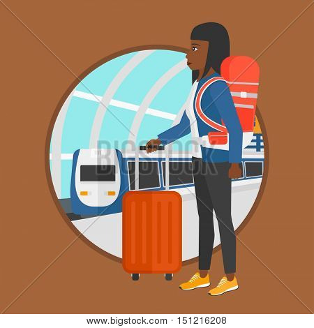 African-american woman standing at the train station on the background of arriving train. Woman with suitcases waiting for a train. Vector flat design illustration in the circle isolated on background