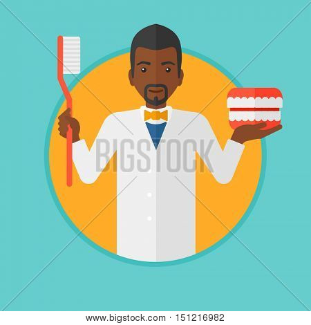 An african-american dentist holding dental jaw model and a toothbrush. Male dentist showing dental jaw model and toothbrush. Vector flat design illustration in the circle isolated on background.