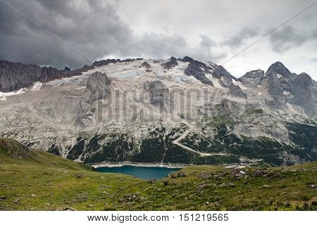 view of northern side or nort face of mount Mmarmolada with lago di Fedaia - top of dolomites South Tirol Italian Dolomites