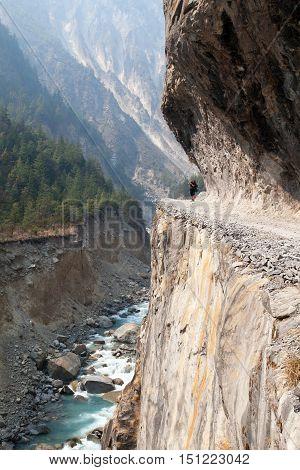 man on the way rock road in round Annapurna circuit trekking trail Nepal