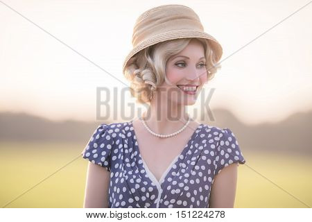 Smiling Woman Wearing Retro 1920S Clothing. Standing In Rural Summer Landscape.