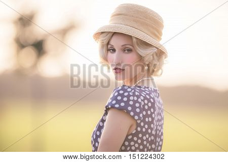 Seductive Looking Woman Wearing Vintage 1930S Fashion. Standing In Rural Summer Landscape.