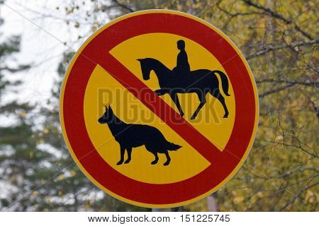 Traffic sign. No dogs allowed and no horse allowed.