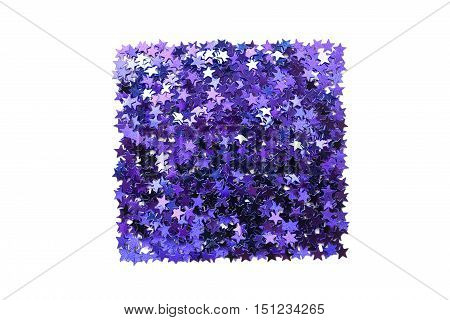 Squared pile of purple metallic sparkles isolated over white