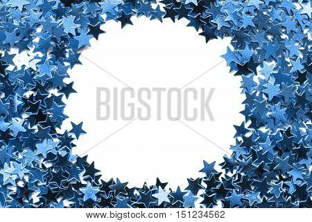 Blank circle frame of blue confetti as a background