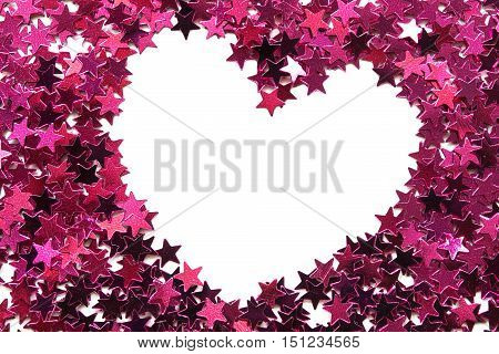 Heart shaped blank frame of pink confetti as a background